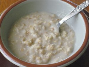Porridge in a Bowl with a Spoon